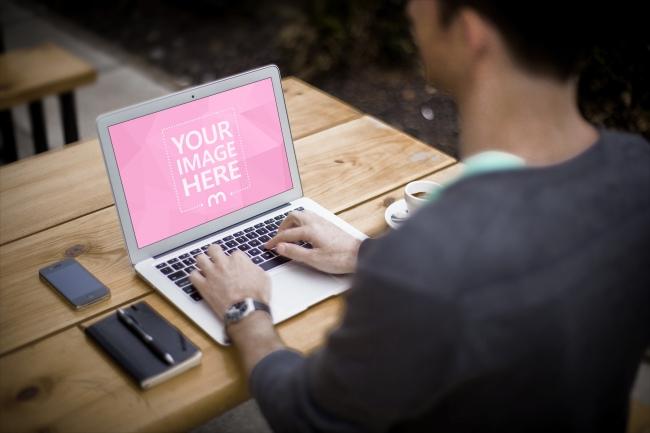 Man Working on Macbook Laptop