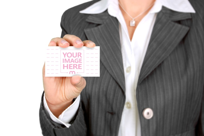 Woman Holding Blank Business Card Mockup Template preview image