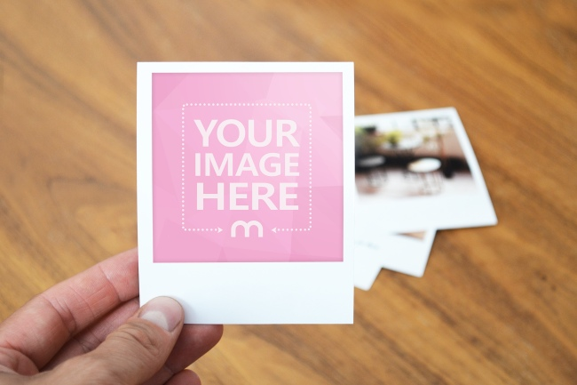 Man Holding Polaroid Picture Mockup preview image