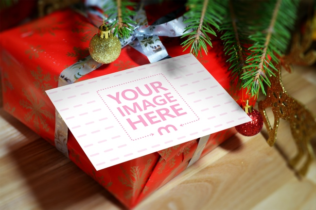 Card on a Christmas Present Mockup preview image
