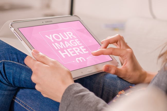Woman Browsing on a White Samsung Tablet Computer preview image