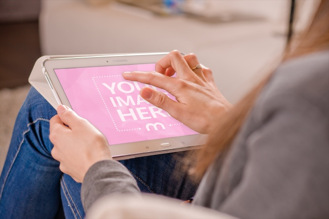 Woman Using White Samsung Tablet Computer preview image