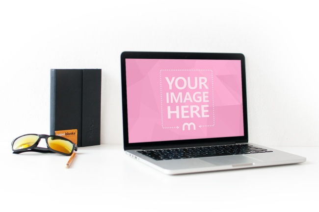 Free Macbook On Table Online Mockup preview image