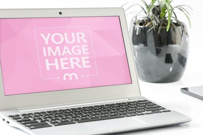 Laptop On Desk Mockup Template