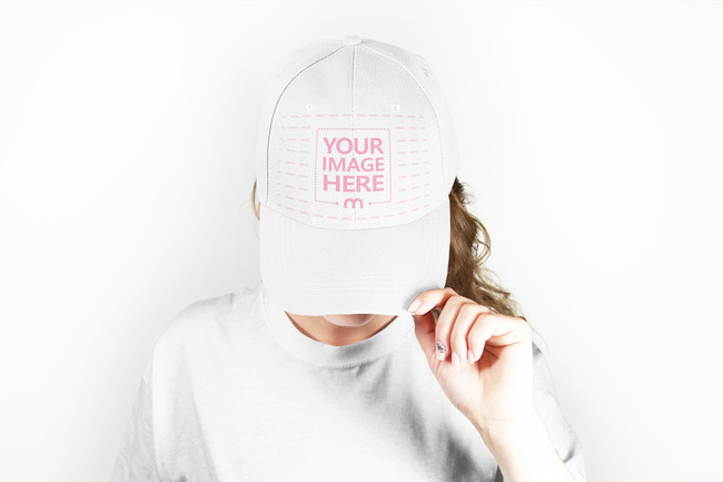 Woman Showing Off Baseball Hat Design Mockup preview image
