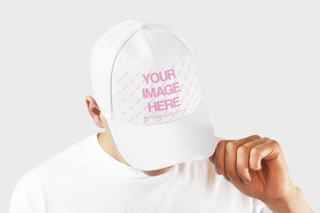 Closeup of a Man Showing off Snapback Hat Design Mockup preview image