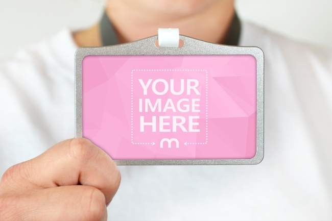 Close-up Shot of Holding a Name Tag in Hand preview image