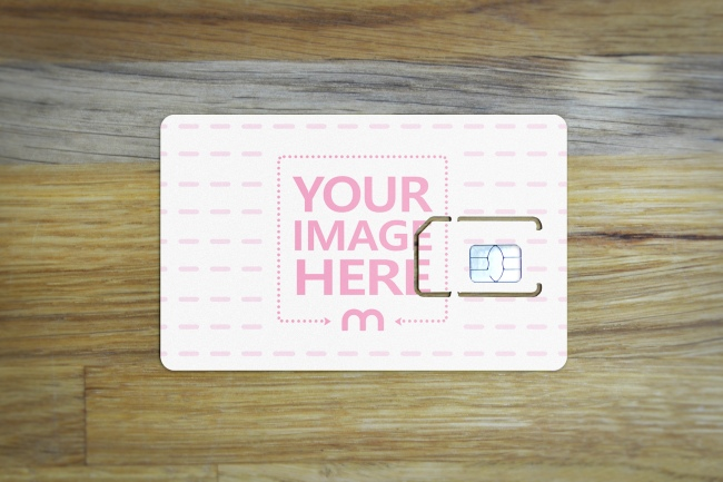 SIM Card Lying on Wood Background Online Mockup preview image