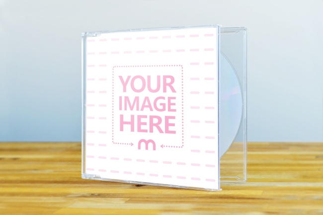 Clear CD Case on Wood Surface Mockup preview image