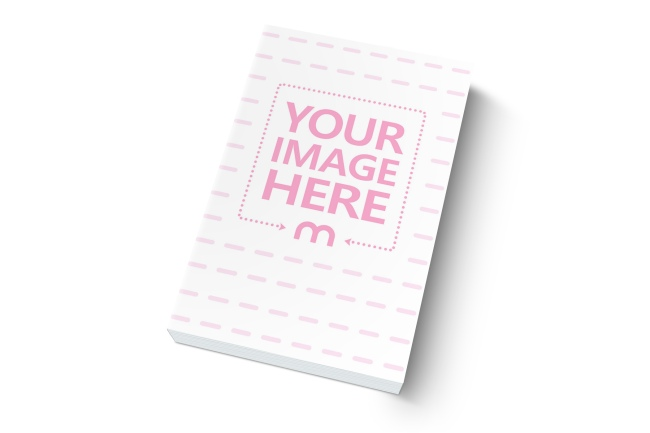 Softcover Book Lying on White Surface Mockup Generator preview image