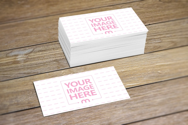 Stack of Business Cards on Wood Surface Mockup preview image