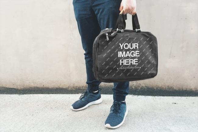 Man Holding Black Laptop Bag Mockup