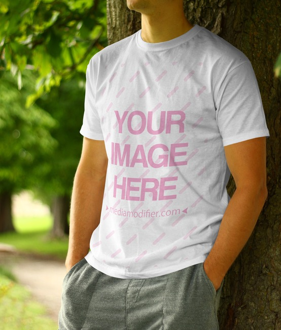 T-Shirt Mockup with Young Man Leaning Against Tree preview image