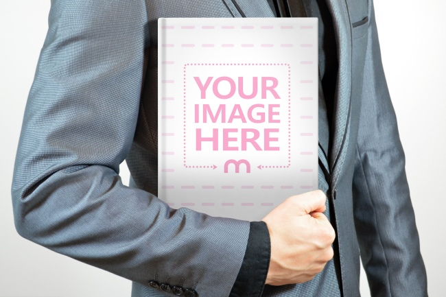 businessman holding a book free online cover mockup generator template