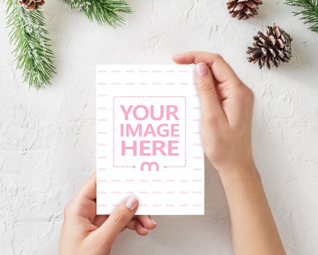 Holding a Christmas Card in Hand Mockup preview image