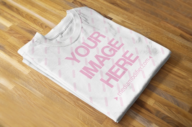 Folded T-Shirt on Wood Background Mockup
