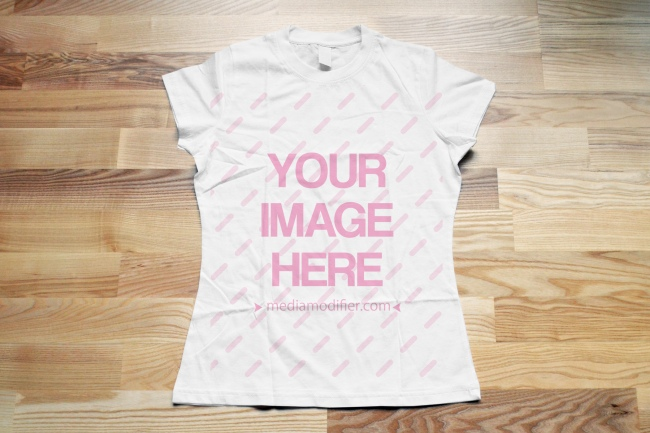 Women's T-Shirt on Wood Floor Background preview image