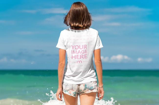 Woman Walking on the Beach T-Shirt Back View Mockup preview image