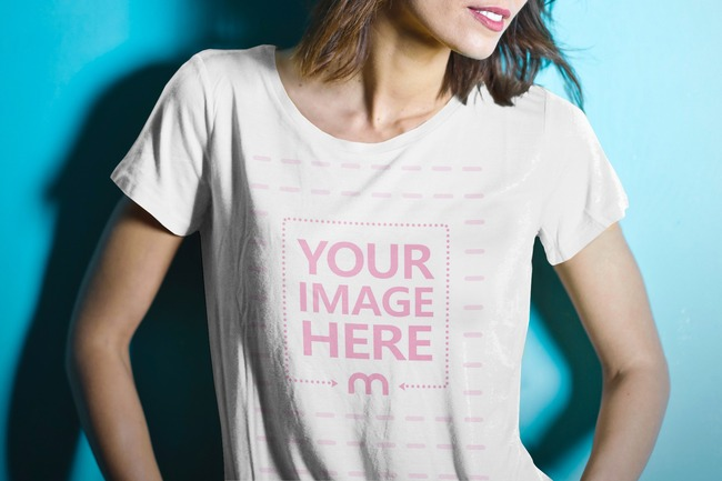 T-Shirt Mockup with Young Woman on Blue Wall Background