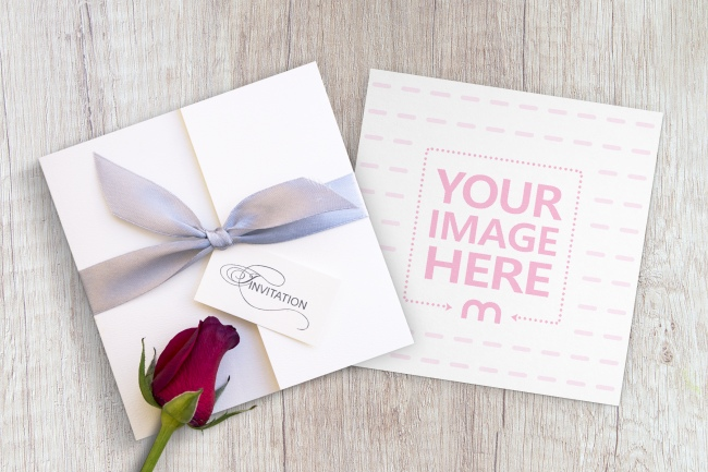 Square Wedding Invitation Card on Wood Table Mockup Generator preview image