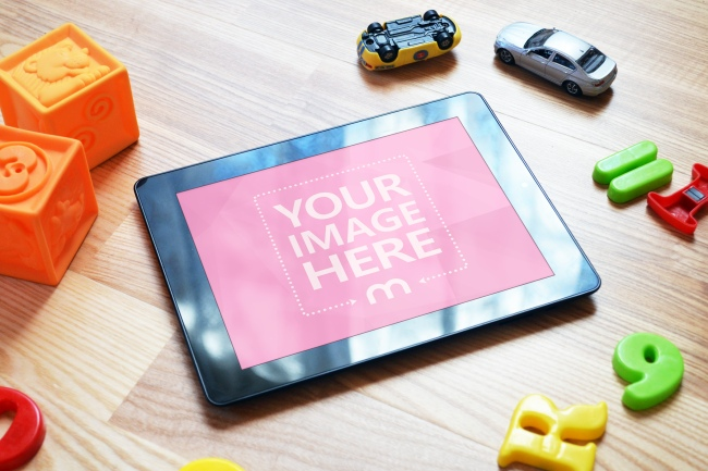 Black Tablet Computer on Kids' Room Floor Mockup preview image