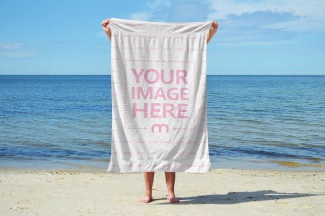 Woman Holding a Towel on the Beach Mockup Generator
