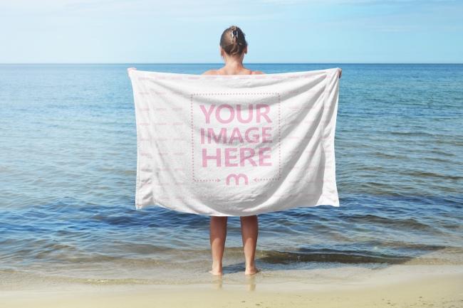 Woman Holding  Towel on the Beach Mockup Generator