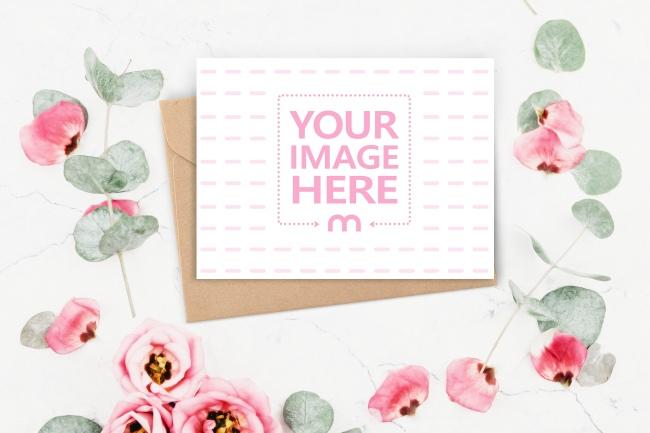 Postcard with Craft Envelope on Floral Background Mockup Generator preview image