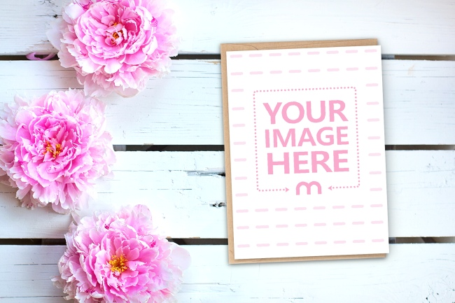 Portrait Card with Envelope on Flowers Backround Mockup preview image