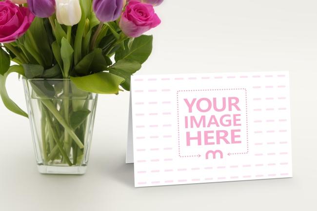 Landscape Folded Greeting Card on Flower Vase Background Mockup preview image