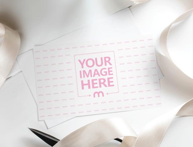 Landscape Postcard with Envelope on Desk Mockup preview image