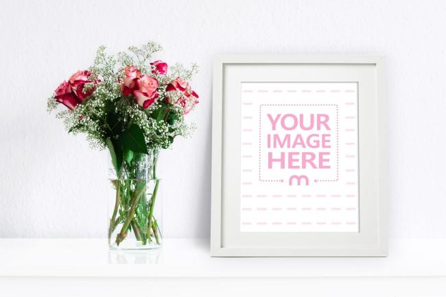 White Photo Frame Next to Flower Vase Mockup preview image