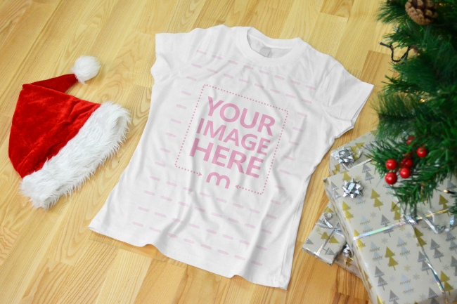 Women's Christmas T-Shirt on Wood Floor Mockup Generator preview image