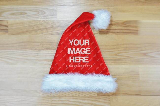 Red Santa Hat on Wood Floor Mockup Generator preview image