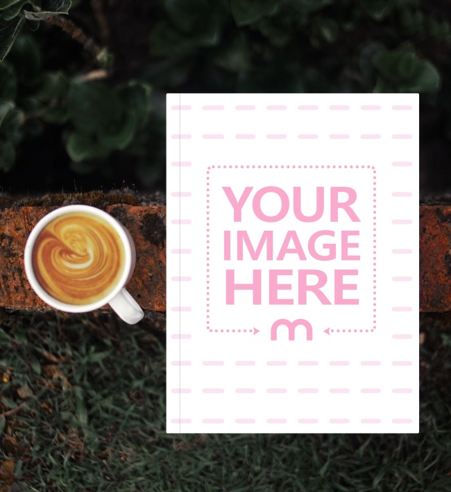 Book Lying Outdoors Next to Coffee Mug preview image