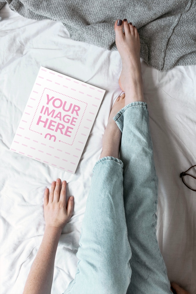 Woman Reaching for Magazine on Bed Mockup preview image