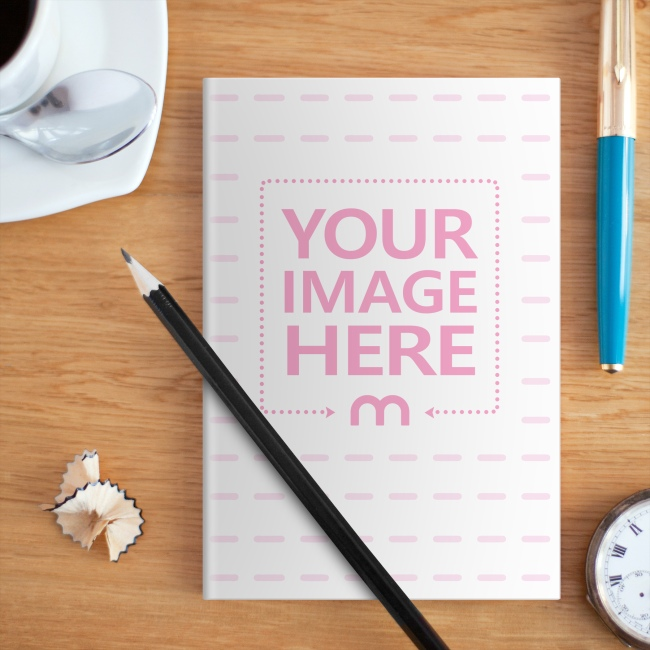 Notebook on Wood Desk Cover Mockup Generator preview image