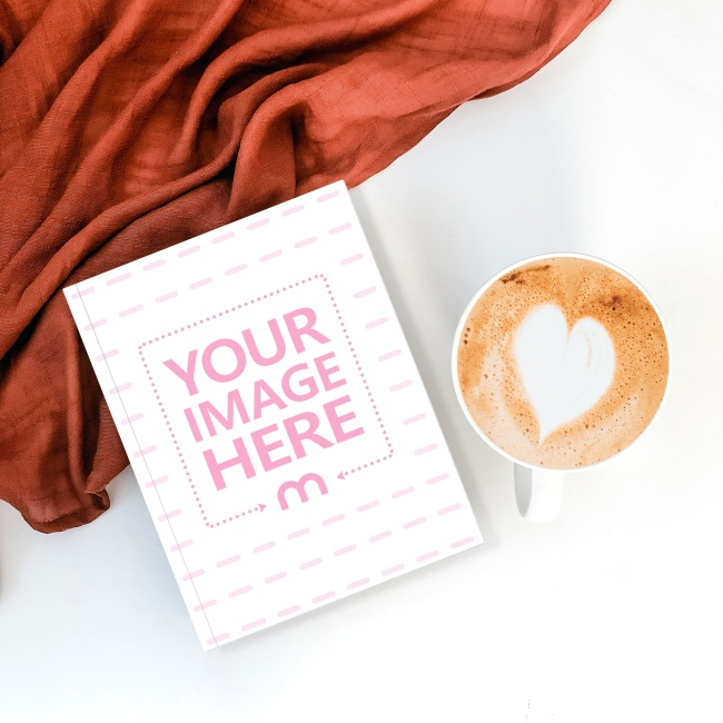 Book Lying Next to Coffee Mug Mockup Generator preview image
