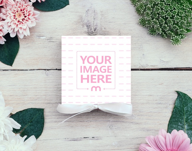 Square Greeting Card on Wood Table with Flowers Mockup Generator preview image