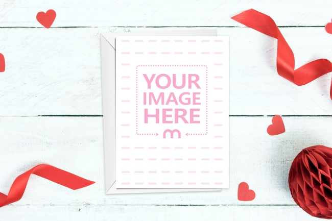 Portrait Postcard on Table with Red Decorations Mockup Generator preview image