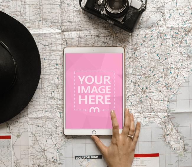 White iPad on Large Map Mockup Generator
