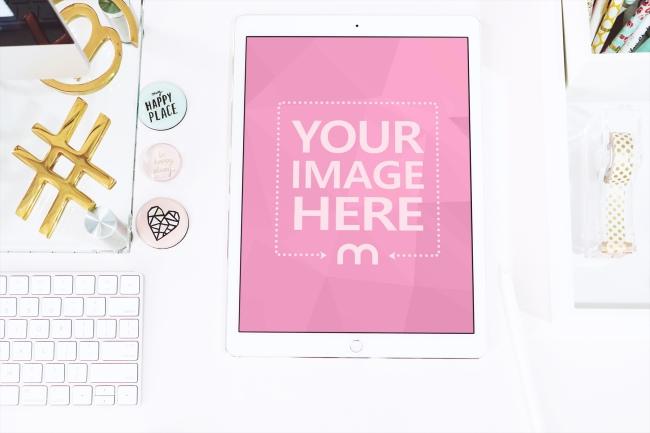White iPad on Work Desk Scene Mockup Generator preview image