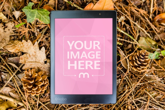 E-Book Reader Lying Outdoors on Forest Ground Mockup Generator