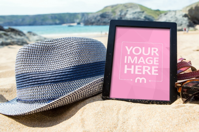 E-Book Reader Tablet Lying on the Beach Mockup Generator
