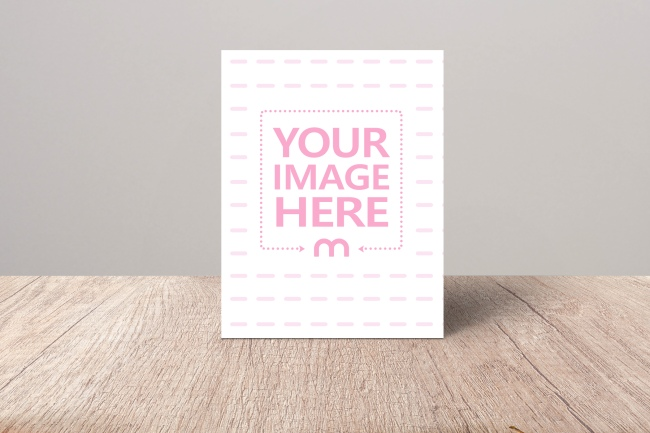Portrait Greeting Card Standing on Wood Surface Mockup preview image