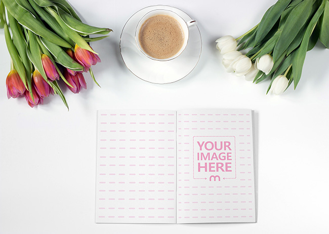 Open Notebook on Desk with Flowers preview image