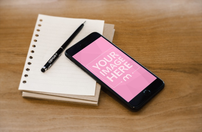 iPhone and Notebook on Wood Table Mockup Generator preview image