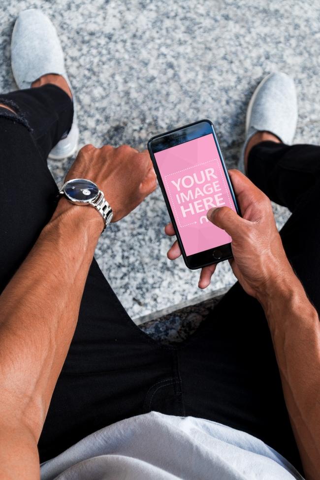 Muscular Man Using Black iPhone Mockup Generator preview image