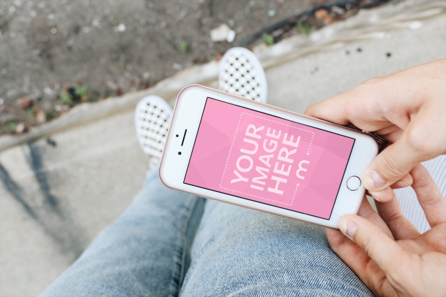 Woman Looking at iPhone on the Street Mockup Generator preview image