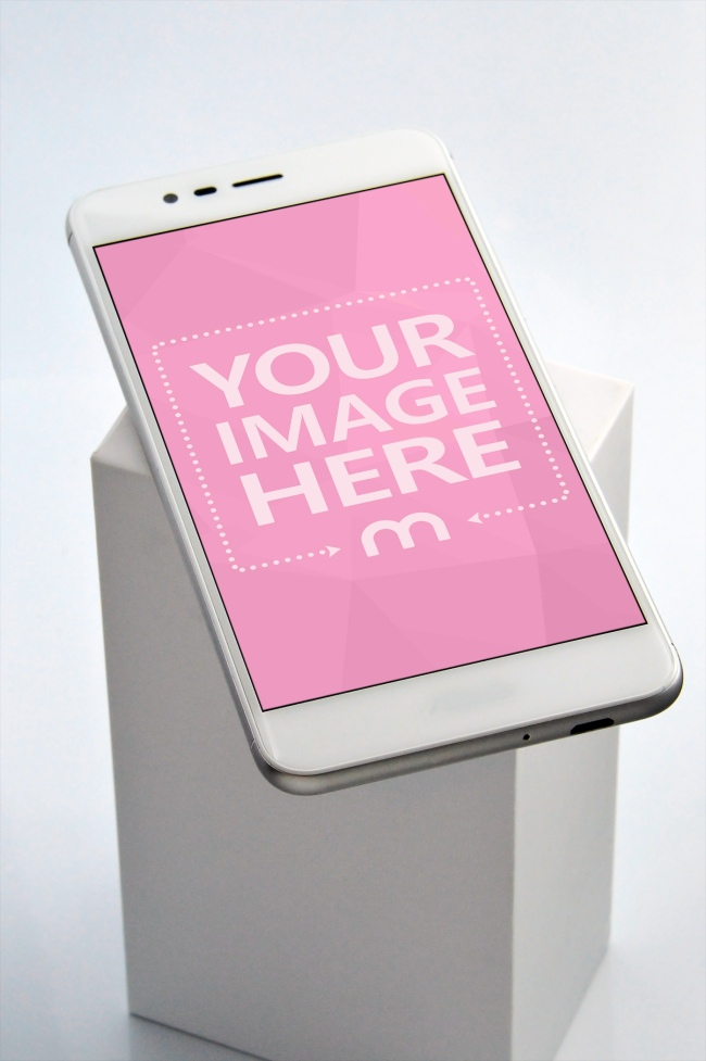 White Smartphone on top of Box Mockup Generator preview image